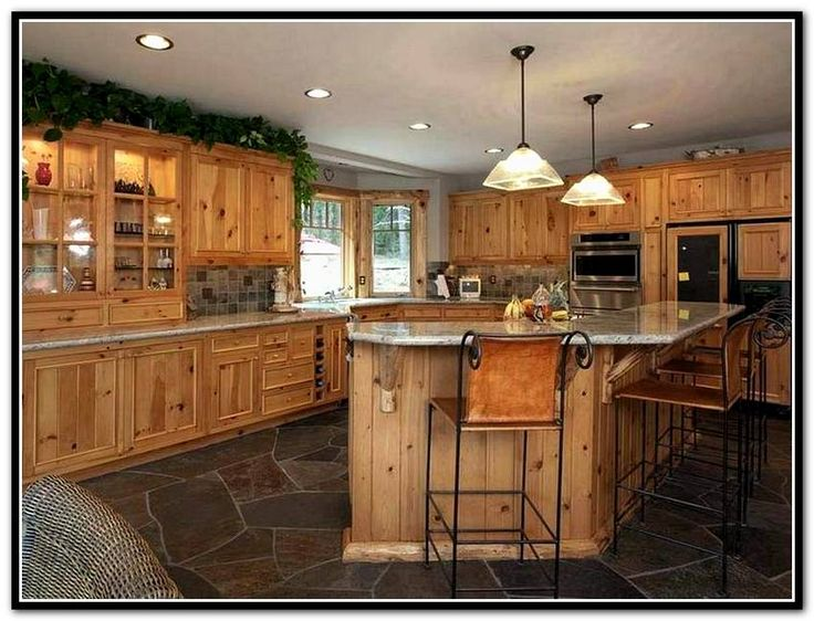 Rustic Kitchen - the knotty alder cabinets and natural stone floor ...