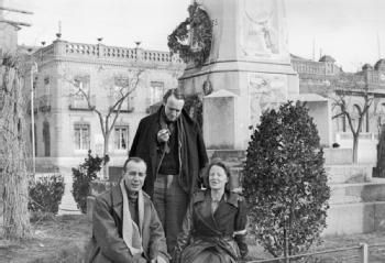THE INTERNATIONAL BRIGADE DURING THE SPANISH CIVIL WAR, DECEMBER 1936 - JANUARY 1937 Journalists Philip Jordan (News Chronicle), Herbert Matthews (New York Times), and Kajsa Rothman (Swedish) pose by the Cervantes statue in Alcala de Henares. Posters can be seen pasted to the statue.