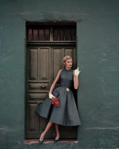 May 1955    Model is wearing a two-piece slate blue dress by Heatherlane in McBratney Irish.    Image by © Condé Nast Archive/Corbis