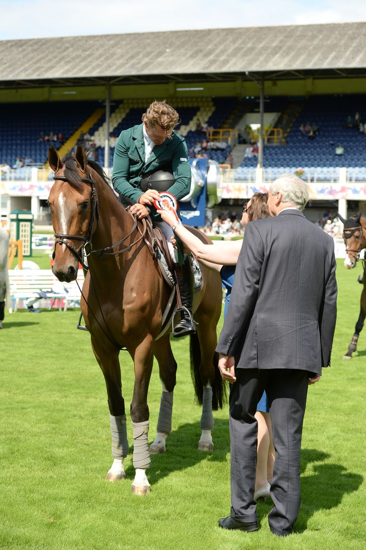 Presenting the rosette to the winner of the Avery Crest sponsored event
