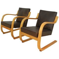 Pair of Lounge Chairs 34/402 by Alvar Aalto