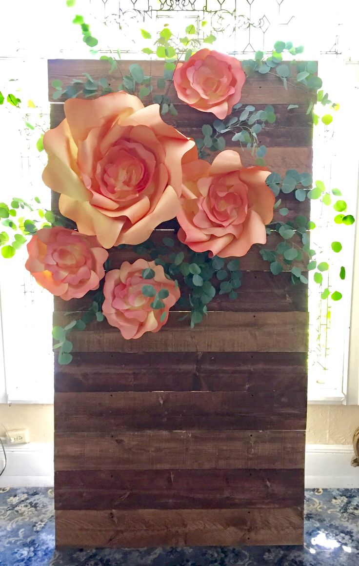 Floral backdrop! Handmade, hand-dyed paper flowers on pallet wood slatted wall! @thecreativebuttinski #thecreativebuttinski