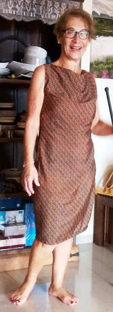 This crepe silk dress is made from a saree. Discarded the pallu and border. Used only the inside fabric. It has a lovely fall and print. I gave a cowl neck and no sleeves.
