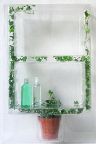 Ivy Shelf, Dominic Wilcox, 2002  Clear plastic, ivy plant    A transparent plastic shelf with space for an ivy plant to grow.    'Illustrations of flowers, leaves and vines have for many years been used as decoration on everyday objects. This Ivy Shelf takes that idea back to its source. A real ivy plant grows inside a transparent shelf. The ivy takes on the role of decoration while happily living inside the 'green house' shelf.'