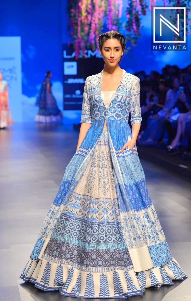 A printed crop-top & #lehenga paired with a matching long #jacket by #AnitaDongre