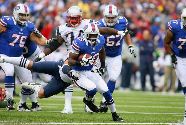 C.J. Spiller #28 of the Buffalo runs against the New England Patriots in the first half at Ralph Wilson Stadium on September 30, 2012 in Orchard Park, New York.