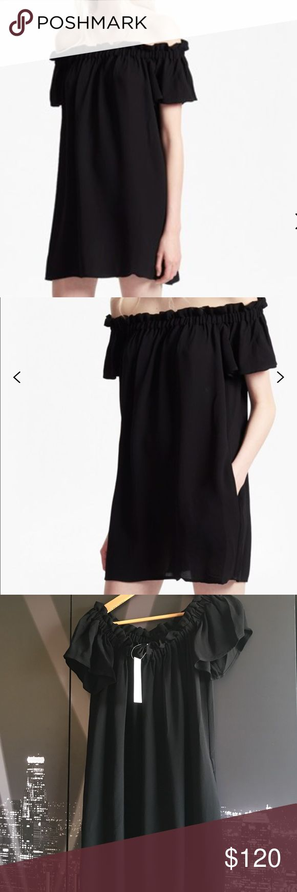 French Connection Ruffle Dress French Connection oversized Evening Dew Bardot dress makes the shift between day and night utterly seamless. It has fluted angel sleeves with a ruffle-trimmed neckline to add some femininity, while  the rest remains simple, allowing for plenty of style. Perfect to wear in the day with black suede ankle boots or in the evening, wear with 2 strap heels. French Connection Dresses Mini