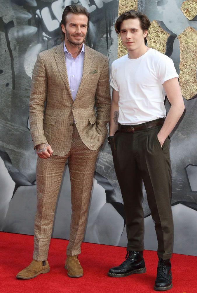 The Best Dressed Men Of The Week: David And Brooklyn Beckham at the King Arthur Premiere, London. #bestdressedmen #davidbeckham #brooklynbeckham