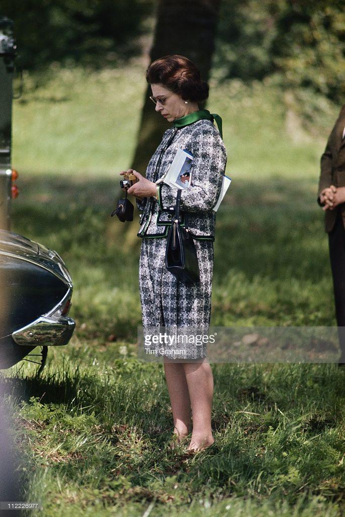 Queen Elizabeth Ii Inspecting Her Gold Rollei Camera