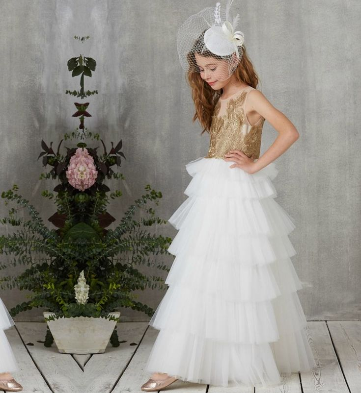 Embroidered Floral Tiered Gown-Made To Order - High Quality Beautiful Sheer Round Neckline Sleeveless Floor Length Tiered Layered Little & Big Girl Embroidered Flower Gown Available from 5 until 13 years. Material: Cotton, organza, tulle mesh. Colors: Gold - Pink, Gold - Black & Gold - White. Please do compare your little girl's measurements with our size chart.