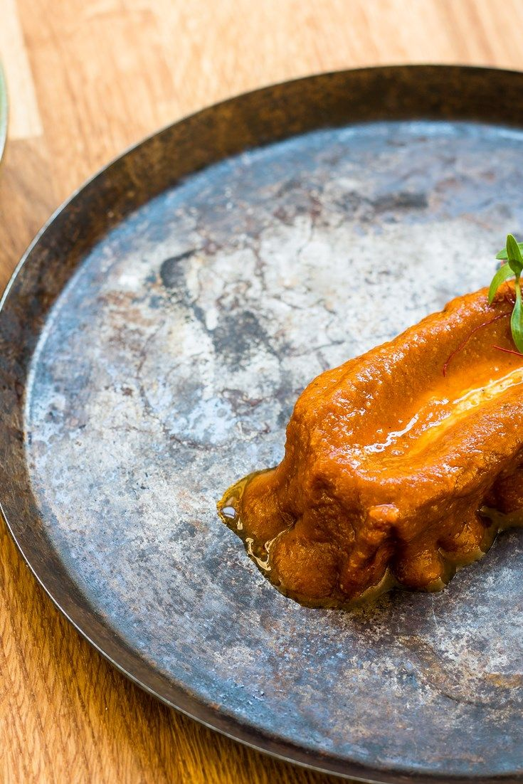 To chef Alfred Prasad, this pork belly vindaloo recipe is 'a thriving confluence of Portuguese, Indian and British food cultures'.