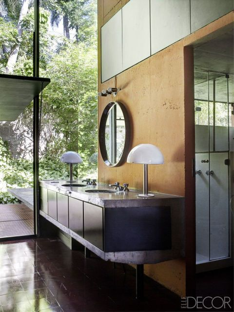 This modern bathroom with such big vision to see outside gives the room fresh and natural atmosphere.