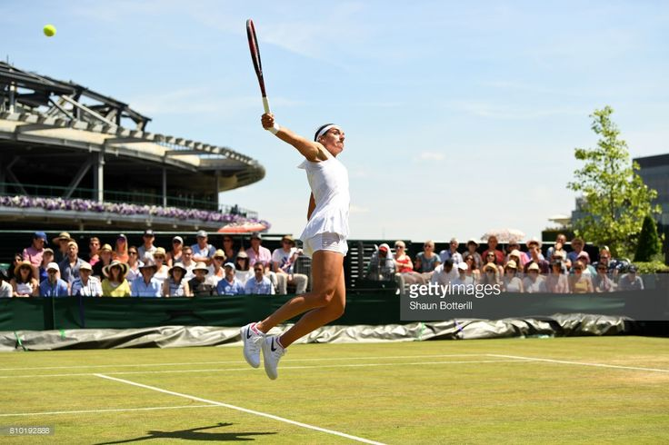 Caroline Garcia of France stretches to play a forehand shot during the Ladies Singles third round match against Madison Brengle of The Unites States on day five of the Wimbledon Lawn Tennis Championships at the All England Lawn Tennis and Croquet Club aon July 7, 2017 in London, England.