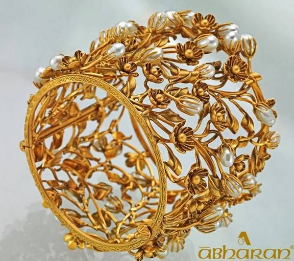 Jewellery Designs: Pearl Studded Gold Bangles