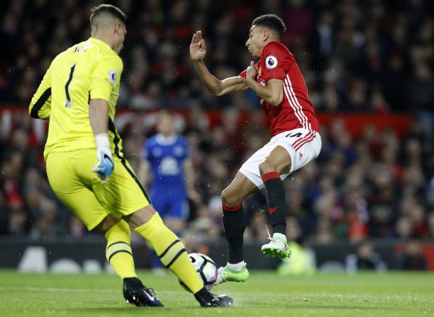 Manchester United's Jesse Lingard challenges Everton goalkeeper Joel Robles during the Premier League match at Old Trafford Manchester