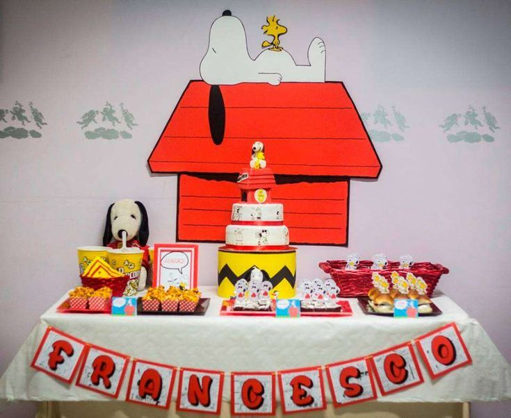 Fantastic dessert table and backdrop at a Snoopy birthday party! See more party planning ideas at CatchMyParty.com!