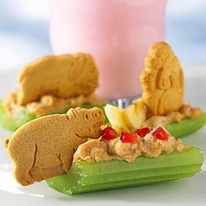 Animal cracker safari snack! NOTE: cream cheese or hummus can be used in place of the peanut butter for the children who are not to be served peanut butter.