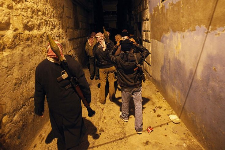 Not Freedom Fighters: Ben Swann Calls Out US Funding Of Terrorists In Syria Syrian rebels walk in an alley in Idlib Syria Wednesday Feb. 8 2012. (AP Photo)  MINNEAPOLIS  Its rare for any journalist in the corporate media to admit that the United States provides any kind of support to terrorists in Syria but thats what happened on a recent episode of Ben Swanns Reality Check.   The Free Syrian Army and the so-called Syrian rebels who have now lost control of Eastern Aleppo are not freedom…