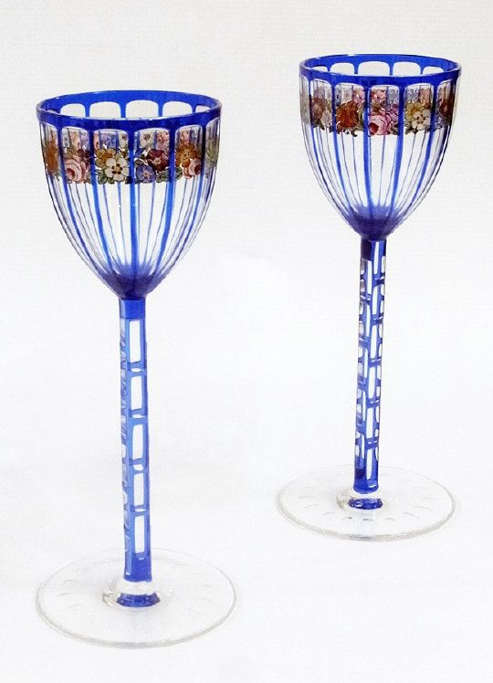 Pair of Otto Prutscher for Meyr's Neffe painted cased and cut wine glasses, circa 1905-1910, retailed by E Bakalowits, Vienna and previously owned by Friedrich Hartmann, 1920's Viennese composer, each 20.5cm high   Estimate £700.00 to £1,000.00 (Lot no: 85 in sale on 05/08/2014) The Cotswold Auction Company
