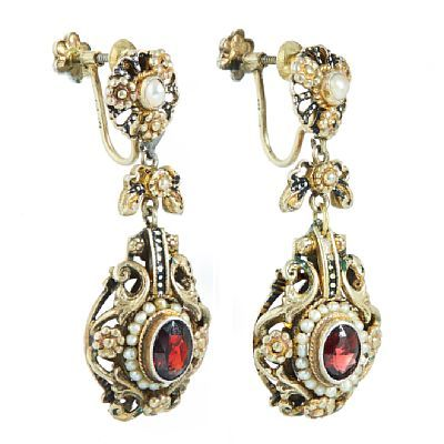 EARRINGS  Silver.  Executive with two rose cut garnets and 40 natural pearls. Multicolored enamel. Screw mechanism. The first part of the 1800s. HEIGHT 5.00 CM