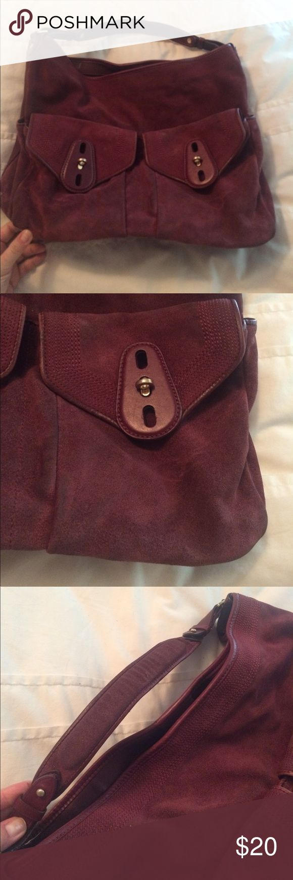 Cole haan large plum suede handbag Being offered is a large coke haan plum suede bag that has been used but still has a lot of life left in it the bag needs to be dry cleaned it has soiling on the edges of the bag from brushing up against stuff no rips or tears I can see. Bag is large it measures 17x12x6.5 front pockets open up and fit a ton. Smoke free home Cole Haan Bags Shoulder Bags