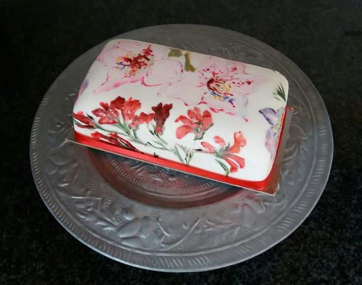 Traditional fruit cake covered in fondant and painted with lilies indigenous to SA nd Watsonias..