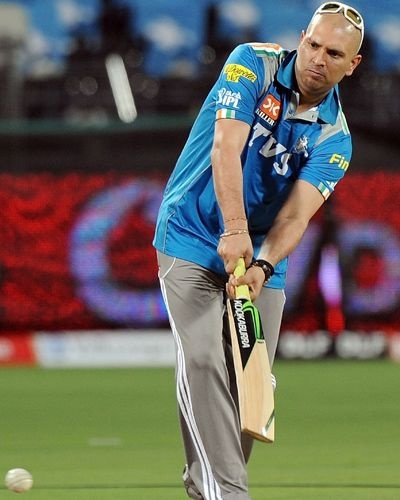 Indian cricketer Yuvraj Singh practices some shots before the start of the IPL Twenty20 cricket match between Pune Warriors India and Deccan Chargers at The Sahara Stadium in Pune on April 26, 2012. Singh on April 11 vowed to return to cricket after recovering from a cancerous tumour, but was unable to set a timeline for his comeback. Yuvraj, 30, returned from the United States where he underwent chemotherapy treatment for a rare germ-cell tumour between his lungs.