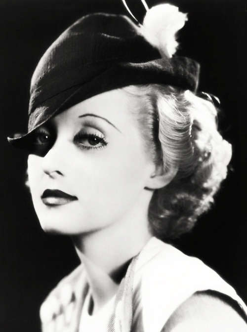 """""""When a man gives his opinion, he's a man. When a woman gives her opinion, she's a bitch."""" - Bette Davis"""