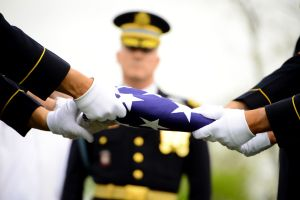 """Soldiers of Delta Company, 3d U.S. Infantry Regiment (The Old Guard), finish folding a flag during the interment of Lt. Col. Don C. Faith Jr., commander, 1st Battalion, 32st Infantry Regiment in Arlington National Cemetery, Va., Apr. 17. After 62 years of being classified as """"Killed in Action body not recovered,"""" Faith Jr.'s remains were found near the Chosin Reservoir in North Korea by a field recovery team. His remains were identified through DNA and reported to the public by Defense…"""