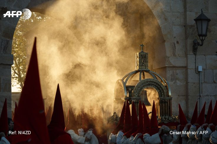 """Penitents from the """"Real Hermandad del Santisimo Cristo de las Injurias"""" brotherhood prepare for a the """"El Silencio"""" procession during Holy Week in the northwestern Spanish city of Zamora on April 12,..."""