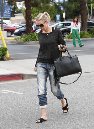 If you're a mature woman, get inspired to look fabulous every day with our round-up of 10 celebrities over age 40 who look stunning in jeans.: Naomi Watts - Carry a Big Bag