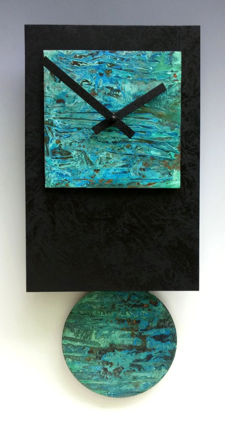 Black Tie Pendulum Clock with Verdigris Copper by Leonie Lacouette. Like the tranquil waters of an Impressionist painting, undulating shades of turquoise, cerulean, and aqua dance upon this serene clock's patinated copper face and pendulum. Black wood background. Uses on AA battery (included). Signed on back. Ready to hang. Each is unique; patina color and pattern will vary.