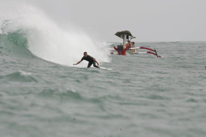 Kuta reef surf spot reach by the traditional boat. http://www.balisurfwaves.com/kuta-reef/