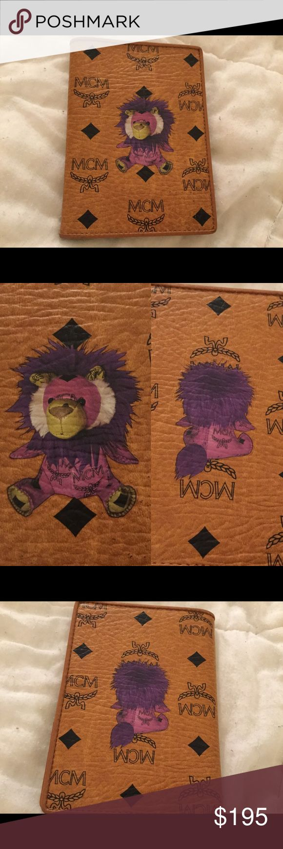 MCM (Munchen) Leather Passport Holder RARE Lion Rare reverse lions  authentic MCM (Munchen) leather passport holder. Features lion on the front and the back of the lion on the back of the passport holder. MCM Bags Wallets