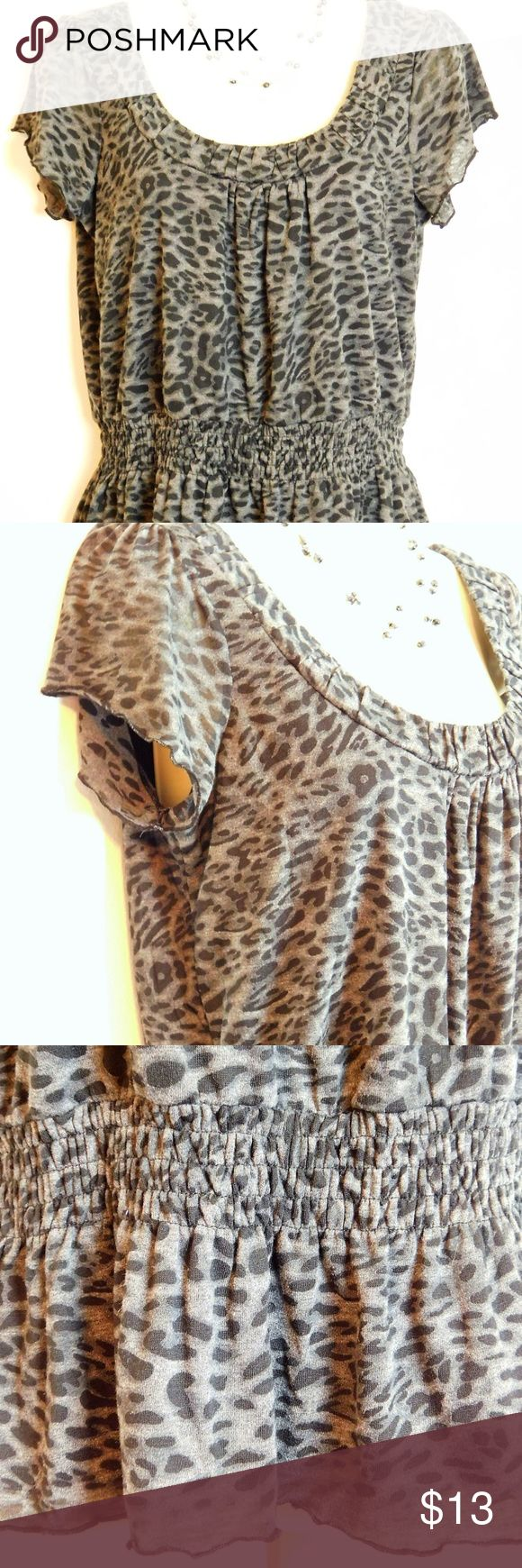 """Animal Print Flutter Sleeve Peplum Knit Top Size M """"JH Collectibles"""" leopard animal print blouse looks great with skinny jeans, pencil skirt with ankle boots EUC excellent pre-owned condition, no visible flaws. Women's size M(8/10) reg Color:  Black Gray Length 22"""", Bust 18"""" across front  Pullover with ruched scoop neckline Short flutter sleeve Allover animal print Smocked elasticized waist with peplum hem Stretch knit construction Fully lined  Fabric & Care 73% polyester, 27% rayon Hand…"""