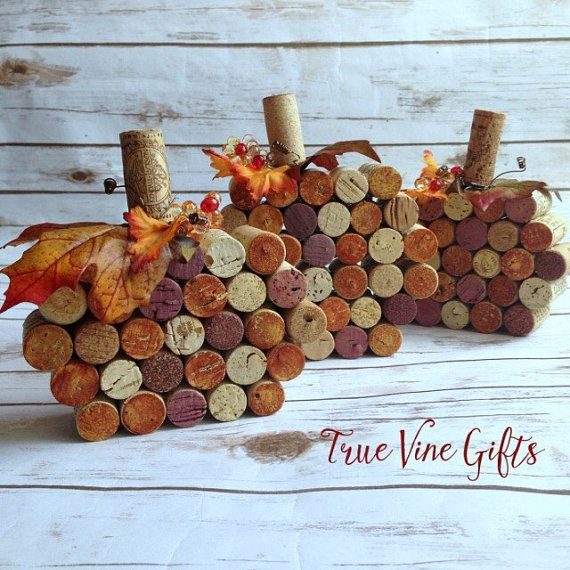 A set of three handmade wine cork pumpkins makes the cutest little pumpkin patch around. The largest pumpkin is 6 inches by 7 inches and the two sampler pumpkins are 6 inches by 6 inches. Pumpkins are made to order and take up to 3 days before shipping. Cork placement and coloring is unique to each individual item.