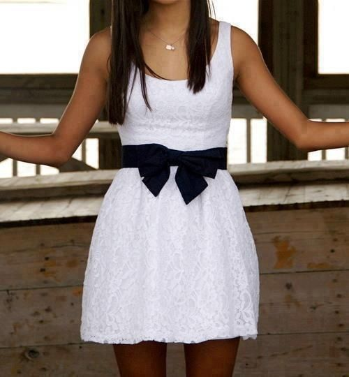 cute, great little white lace sleevless with black sash/bowWow I want this!