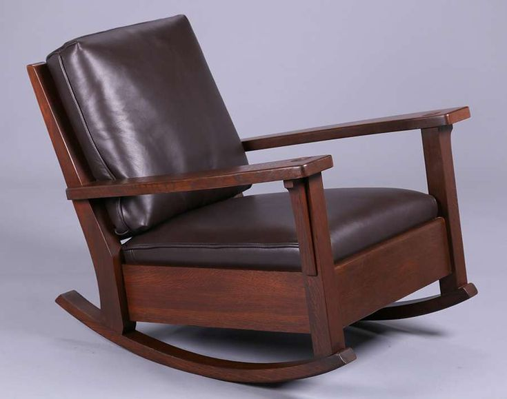 Dramatic Limbert rocker with long, graceful arms.  Signed with branded mark.  Refinished.