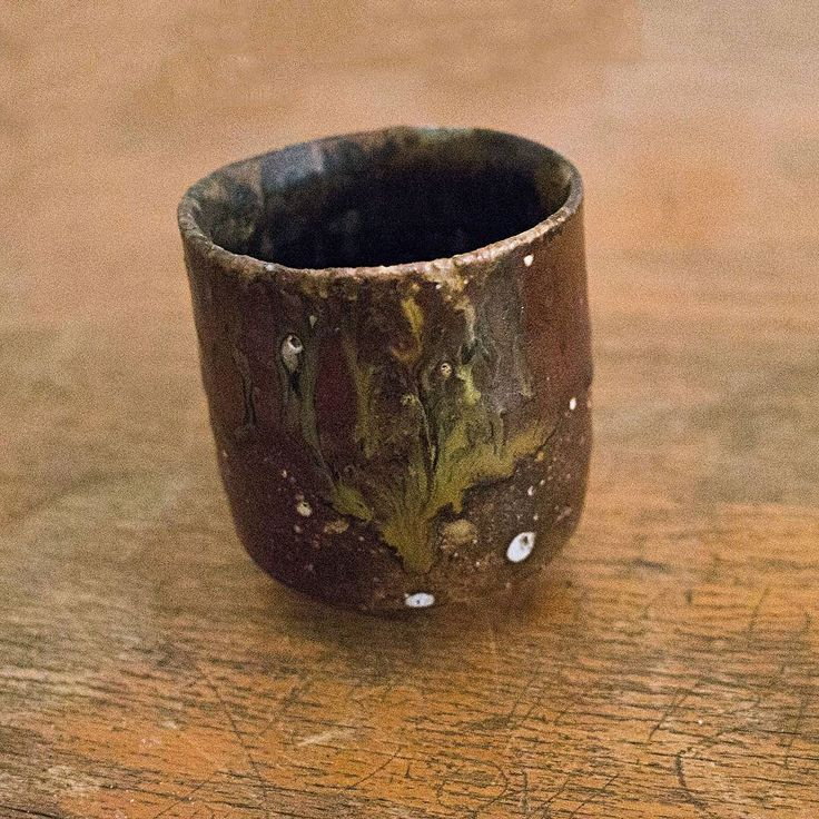 This this one more than any one is the cup that I keep. It is the best cup.  Thrown glazed and fired April 2016 in Kesckemet Hungary. One of a few cups I made during the nights during a week-long workshop learning about glazes. The glaze a tenmoku a mix of 35 individual variations on tenmoku all thrown into a bucket. An old Chinese glaze many glazes can be called an old Chinese (sub.: Japanese Korean) glaze.  A glaze heavy in iron 10% of the glaze by weight powdered red iron oxide Fe2O3 in…
