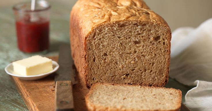 A firm, sweet loaf of golden whole wheat bread.