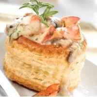 Vol-au-vent au homard.  Lobster Newburg (or Shrimp Newburg, etc), serve in puff pastry. Or use pot pie filling.