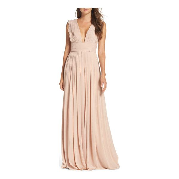 Dainty ruffles soften the precise pleats shaping the decolletage-flaunting bodice of this enchanting chiffon gown. More pleats slim the figure at the