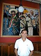 "Roberto Mendez - Owner/proprietor of Taqueria Corona.  We just call him ""happy smiley man"" b/c he always is."