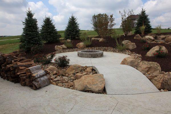 Best 25 concrete fire pits ideas on pinterest for Fire pit on concrete slab
