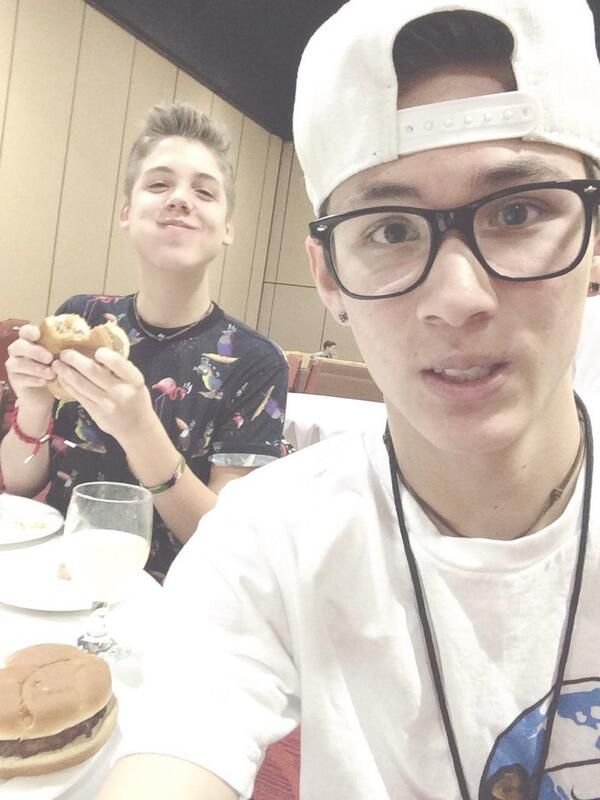 Matt looks so content eating that burger
