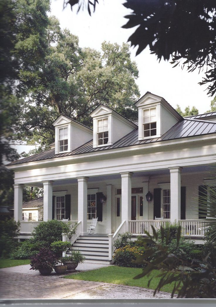 Aside from the exterior design, which I love, I really like the zinc/metal roof and the full width, very deep porch.