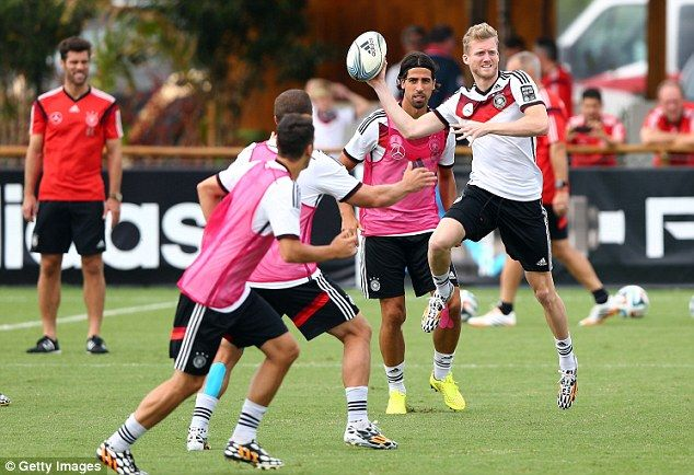 Give it a try: Andre Schurrle seemed to enjoy the unorthodox training methods in Santo And...
