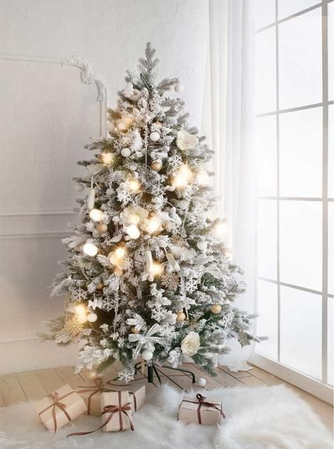 Elegant White Christmas Tree Decorations and Fireplace Backdrop