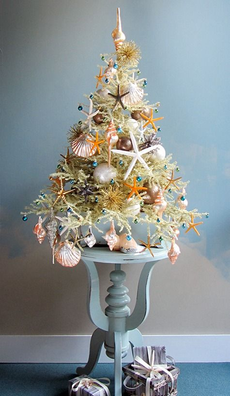 Coastal Mini Christmas Trees | Table Top Tree by Darryl Moland: http://www.completely-coastal.com/2014/12/coastal-mini-trees-table-top-Christmas-trees.html