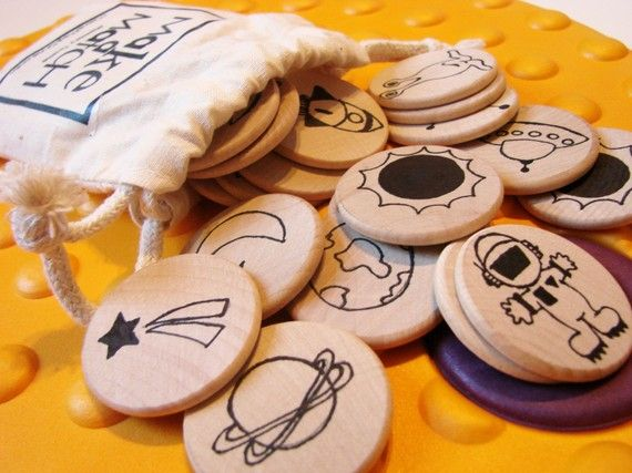 Make a Match memory and matching game. Could make this by stamping on wood circles.